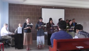 Some of us from Wiang Ping BC singing at the Lanna BC building dedication service. (Evelyn is the third from the left & I am hidden on the back row)